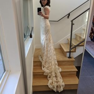 Never worn size 10 ( dress size 6)  wedding dress